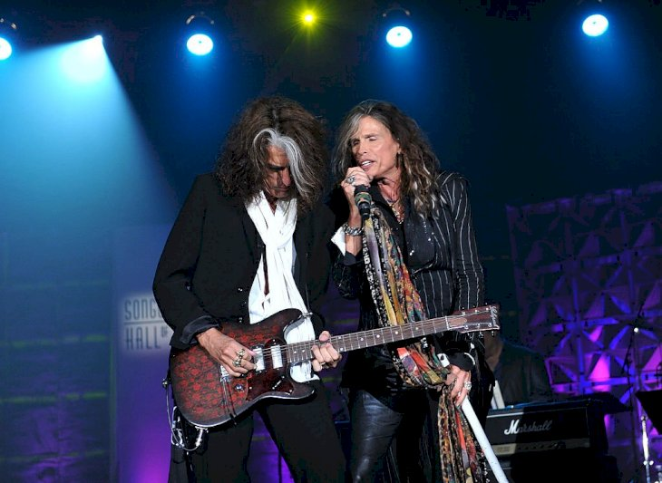Image Credit: Getty Images / Steven Tyler performing on stage with Joe Perry.