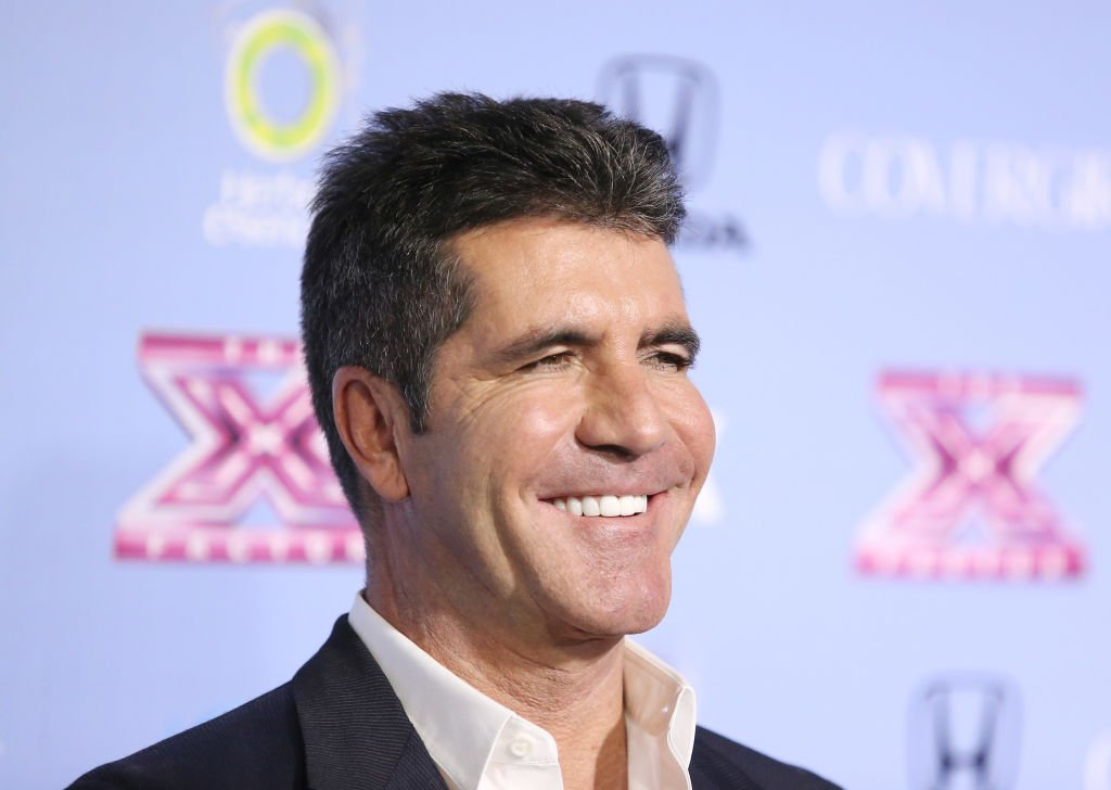"Image Credit: Getty Images / Simon Cowell arrives at ""The X Factor"" finalists party held at SLS Hotel on November 4, 2013 in Los Angeles, California."