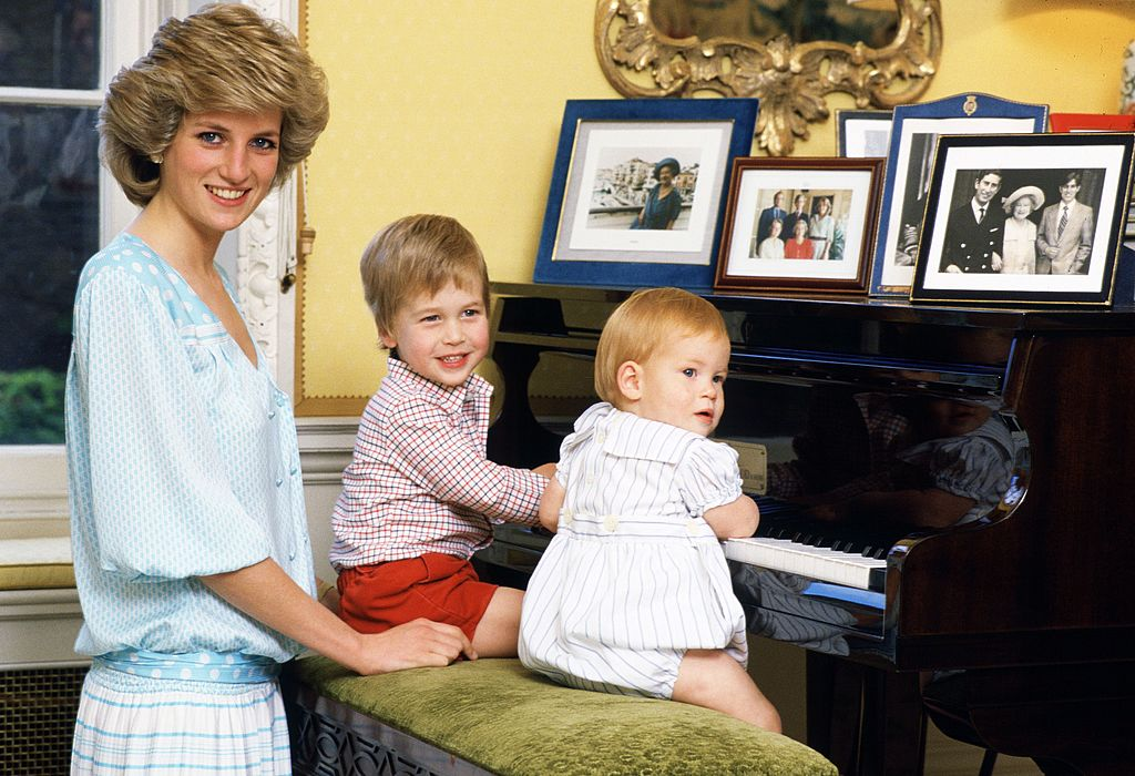 Image Credit: Getty Images / Diana, Princess of Wales with her sons, Prince William and Prince Harry, at the piano in Kensington Palace.