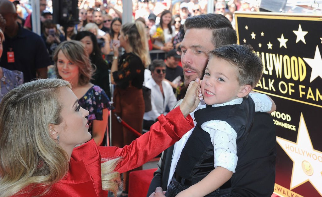 Image Credit: Getty Images /  Musician Carrie Underwood, husband Mike Fisher and son Isaiah Michael Fisher at Carrie Underwood Star Ceremony On The Hollywood Walk Of Fame held on September 20, 2018 in Hollywood.