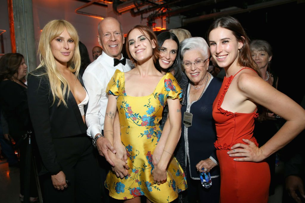 Image Credits: Getty Images / Phil Faraone / VMN18/ | Rumer Willis, Bruce Willis, Tallulah Belle Willis, Demi Moore, Marlene Willis and Scout LaRue Willis attend the after party for the Comedy Central Roast of Bruce Willis at NeueHouse on July 14, 2018 in Los Angeles, California.