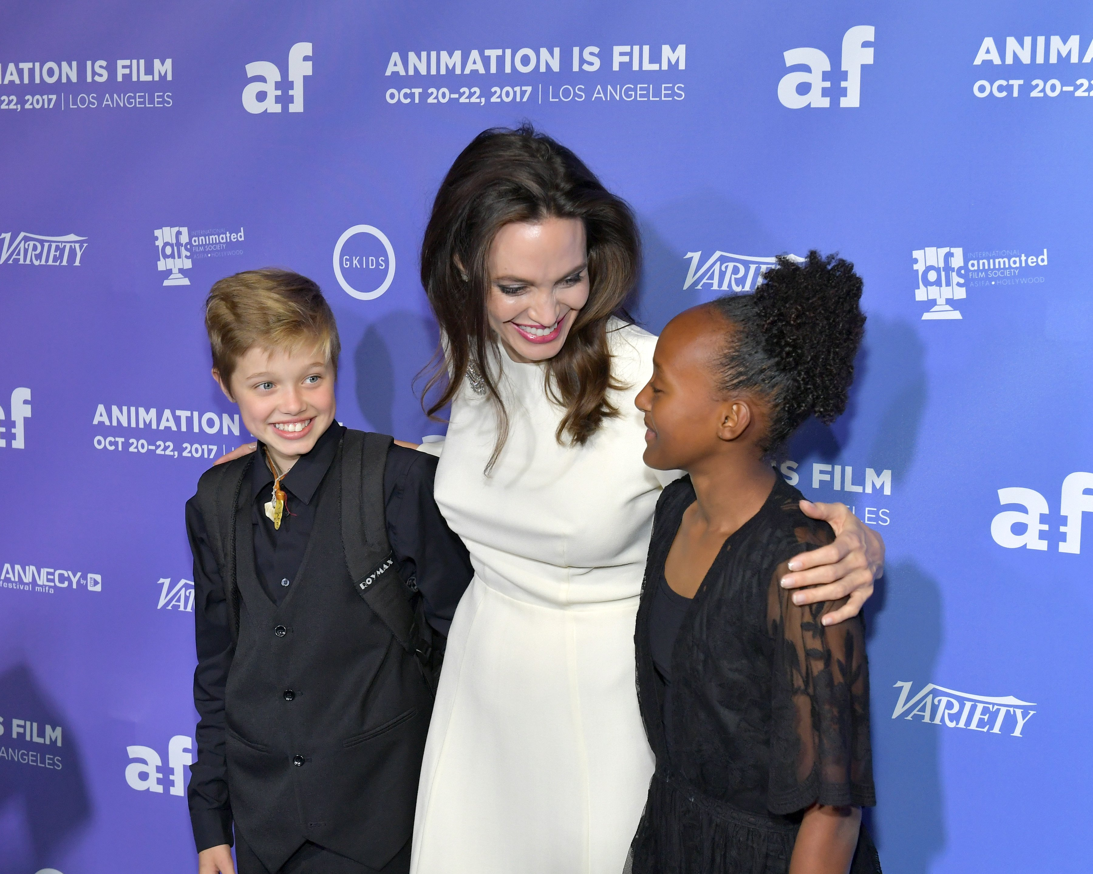 "Image Credit: Getty Images/Neilson Barnard | Jolie with Shilo and Zahara at the ""Breadwinner"" premier"