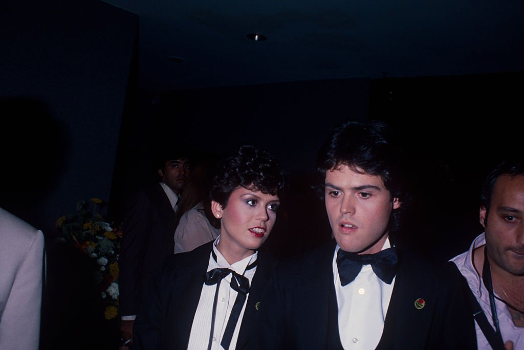 Image Credit: Getty Images / Donny Osmond talking to his sister Marie Osmond at a formal event; circa 1970; New York.