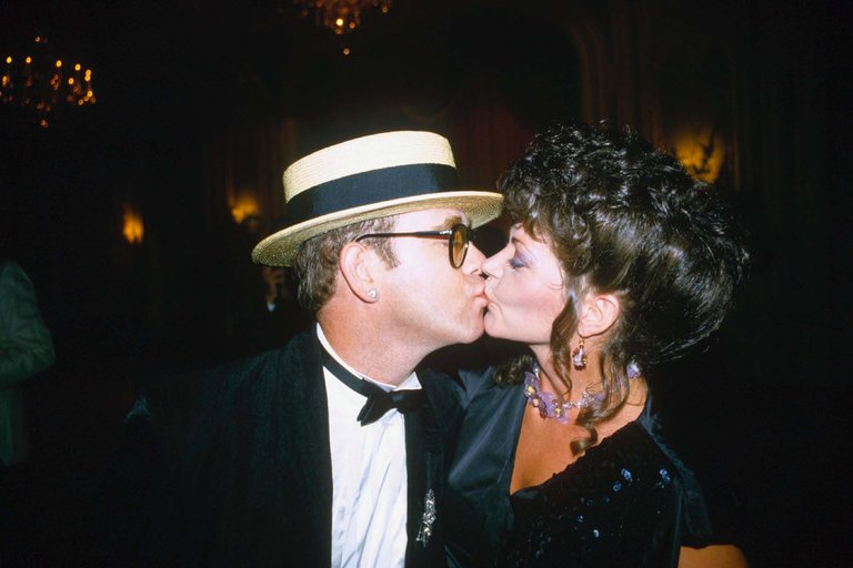 Image Credits: Getty Images / Elton John photographed with his former wife, Renate.