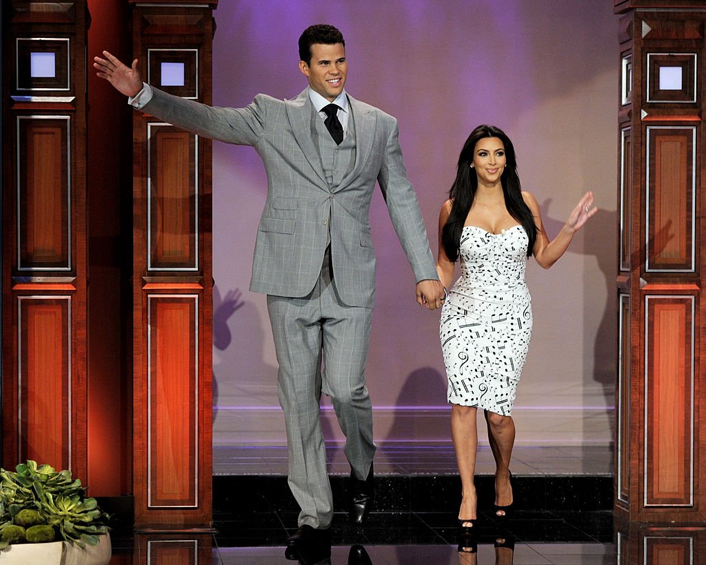 Image Credit: Getty Images / NBA player Kris Humphries (L) and Kim Kardashian appear on the Tonight Show With Jay Leno at NBC Studios on October 4, 2011 in Burbank, California.