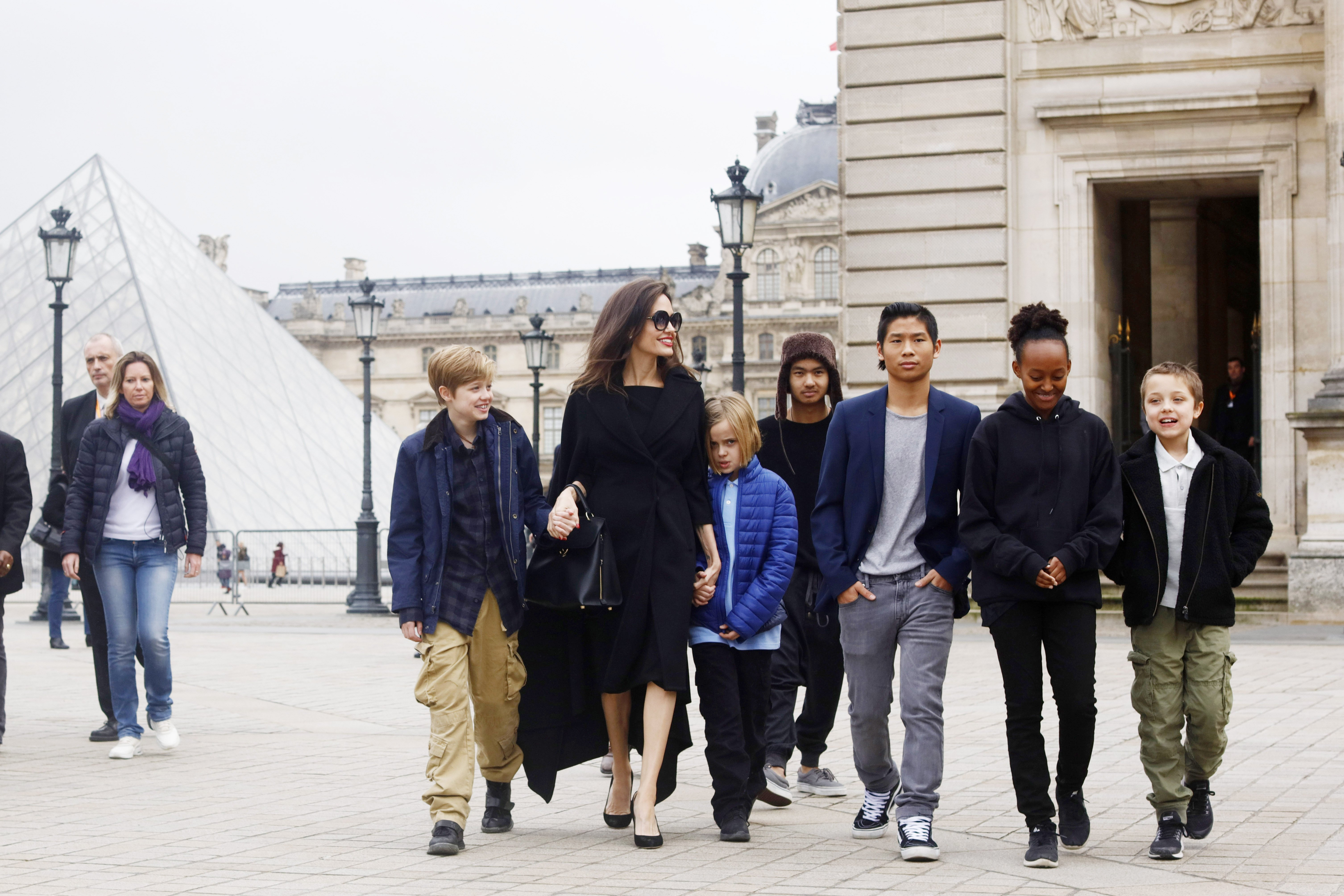 Image Credit: Getty Images/NurPhoto via Getty Images/Mehdi Taamallah | Angelina with all her children in Paris
