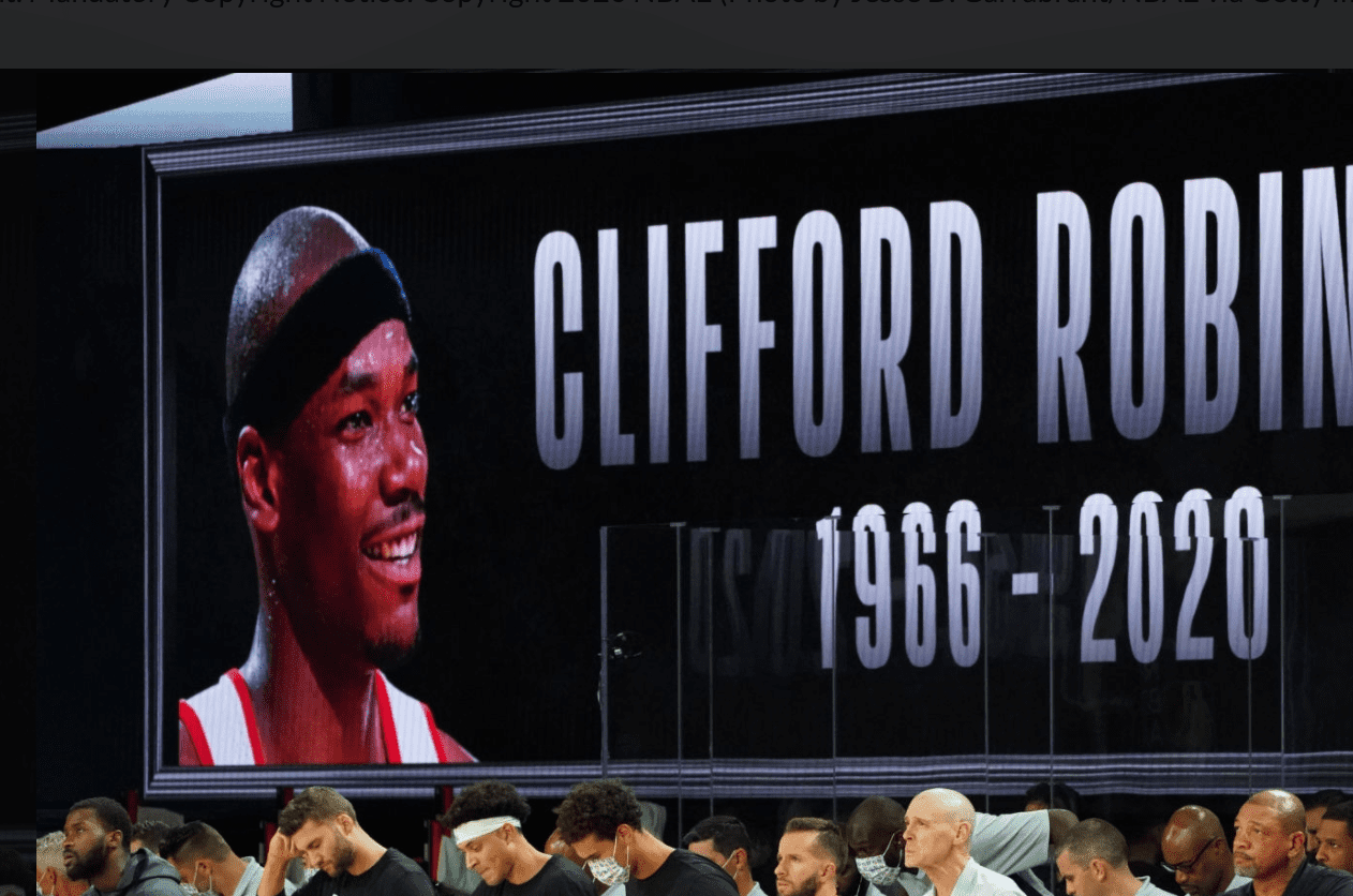 Image Credit: Getty Images / A moment of silence for Clifford Robinson prior to a game between the LA Clippers and the Dallas Mavericks.
