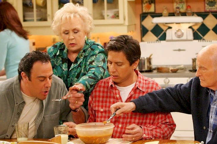Image Credits: Getty Images / EVERYBODY LOVES RAYMOND. From left to right: Brad Garrett, Doris Roberts, Ray Romano, Peter Boyle. Patricia Heaton featured in background.