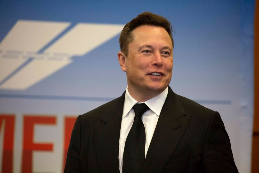 Image Credit: Getty Images / Elon Musk, founder and CEO of SpaceX, participates in a press conference at the Kennedy Space Center on May 27, 2020 in Cape Canaveral, Florida.