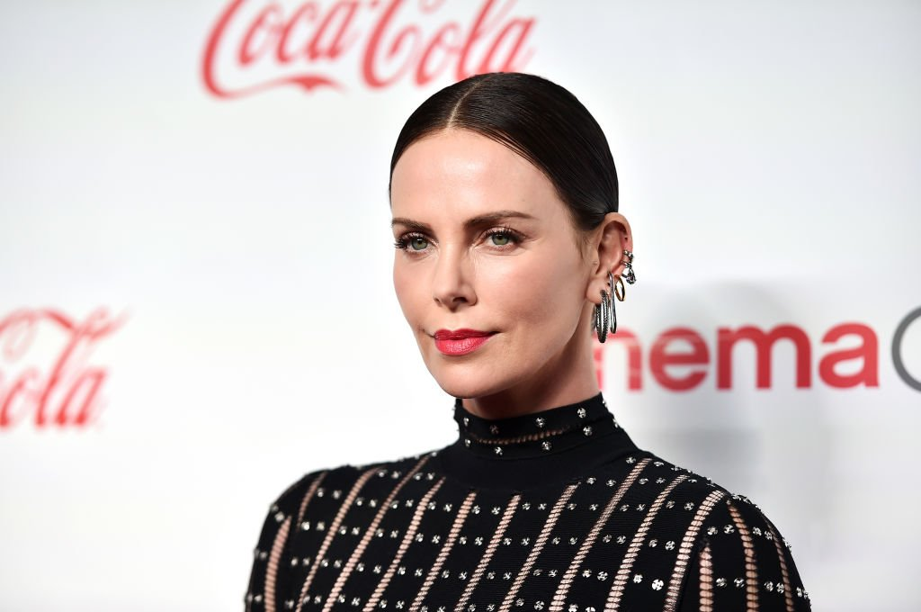 Image Credits: Getty Images / Alberto E. Rodriguez | Charlize Theron attends The CinemaCon Big Screen Achievement Awards Brought to you by The Coca-Cola Company at OMNIA Nightclub at Caesars Palace during CinemaCon, the official convention of the National Association of Theatre Owners, on April 4, 2019 in Las Vegas, Nevada.