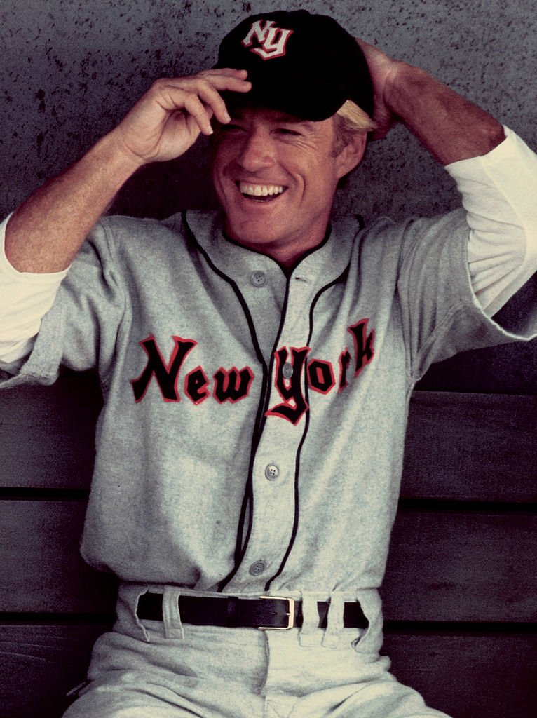 Image Credits: Getty Images / Juergen Vollmer / Popperfoto | American actor Robert Redford stars as baseball player Roy Hobbs in the film 'The Natural', 1983.