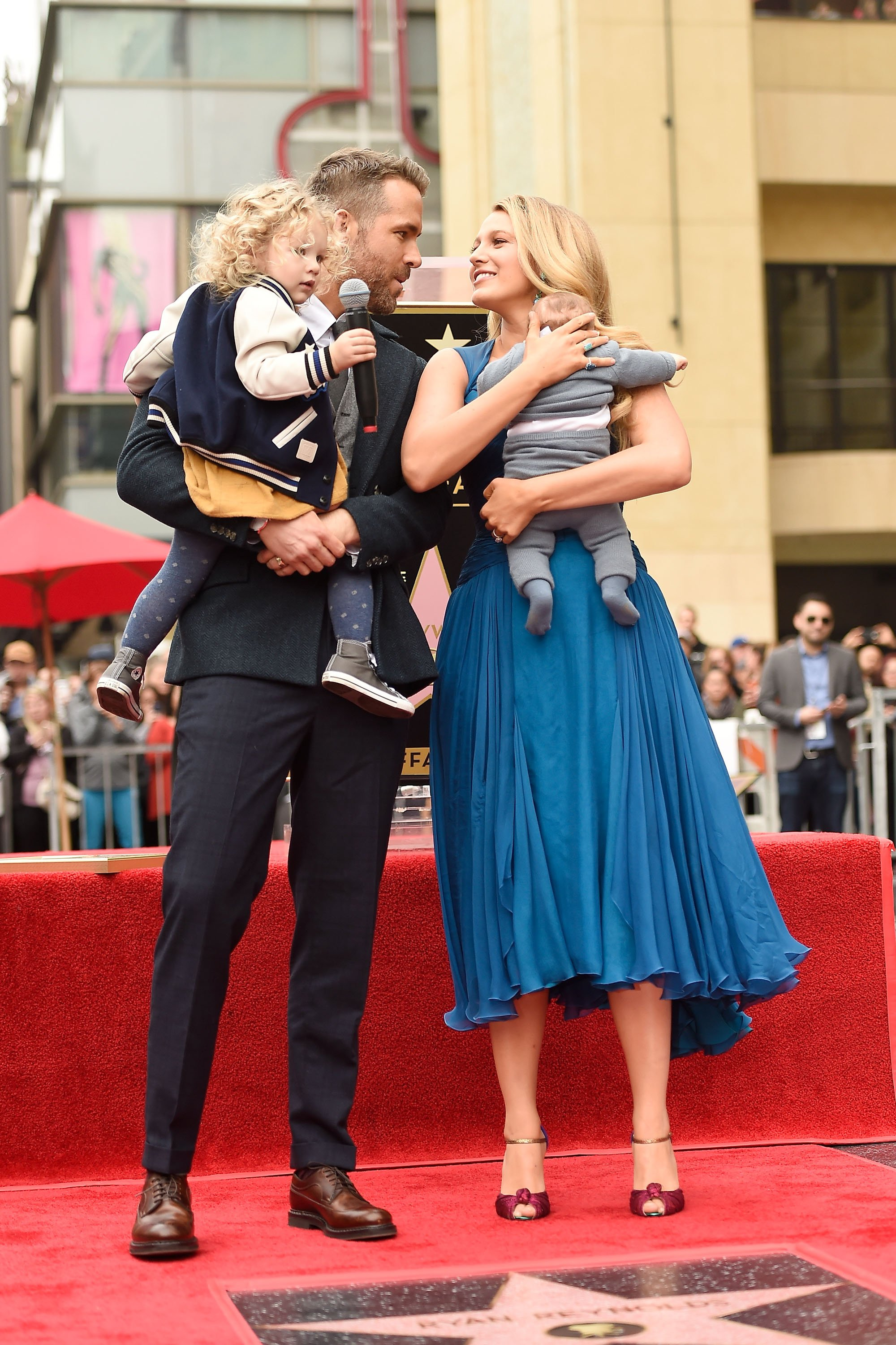 Image Credits: Getty Images / Matt Winkelmeyer | Actors Ryan Reynolds (L) and Blake Lively pose with their daughters as Ryan Reynolds is honored with star on the Hollywood Walk of Fame on December 15, 2016 in Hollywood, California.