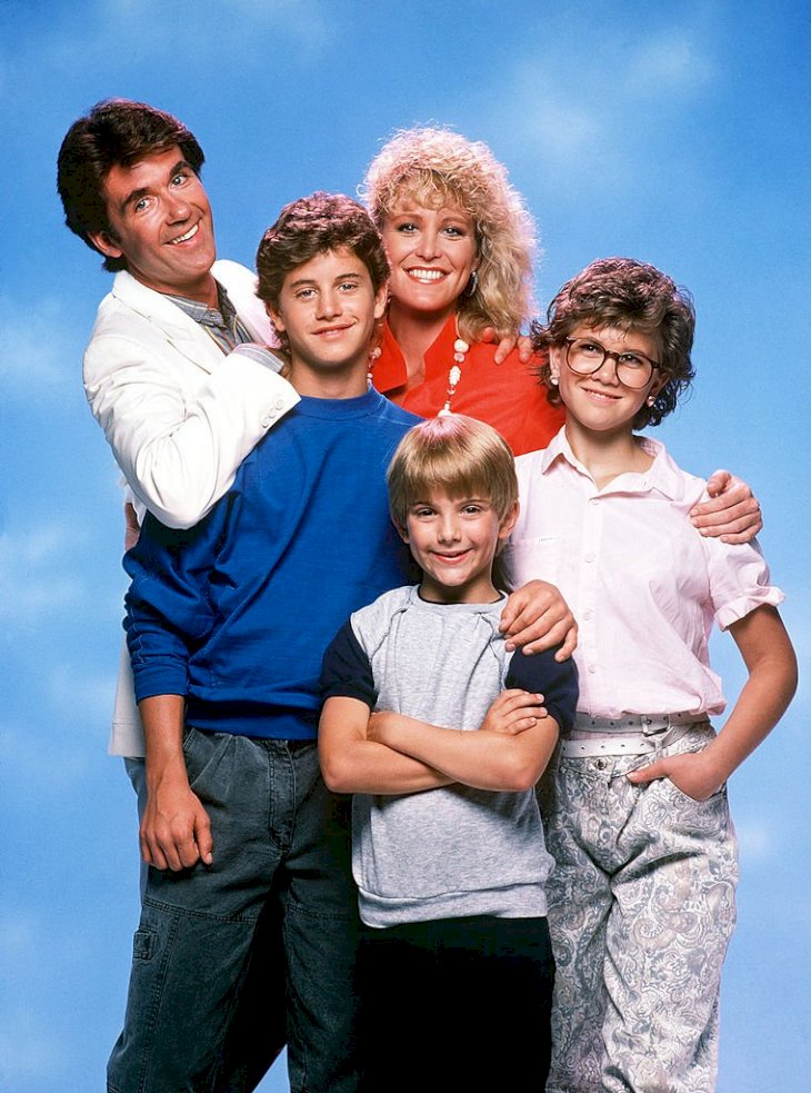 "Image Credits: Getty Images / Walt Disney Television | Cast of the sitcom ""Growing Pains""."