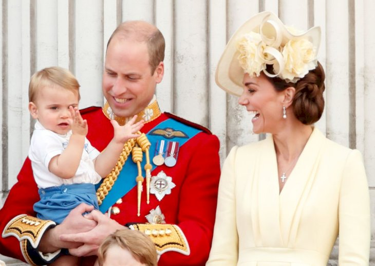 Image Credit: Getty Images / Prince William, Duke of Cambridge, Catherine, Duchess of Cambridge and Prince Louis of Cambridge watch a flypast from the balcony of Buckingham Palace during Trooping The Colour.