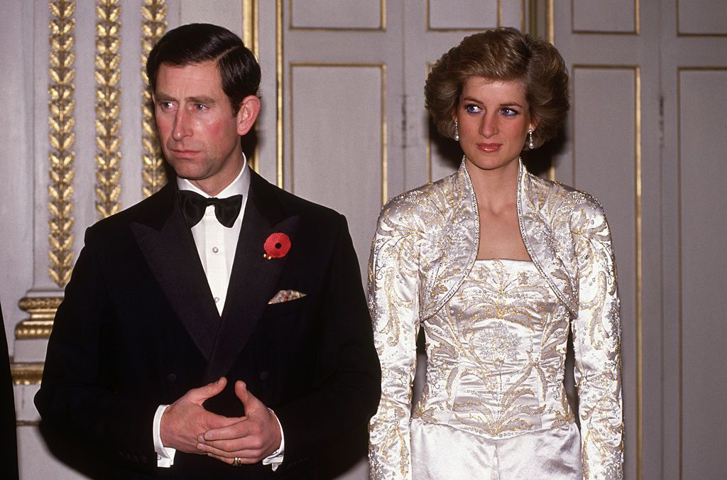 Image Source: Getty Images/David Levenson | Prince Charles and Diana Princess of Wales meet guests arriving at a dinner in the Elysee Palace in Paris