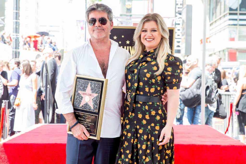 Image Credit: Getty Images / Simon Cowell (L) and Kelly Clarkson attend a ceremony honoring Cowell with a star on the Hollywood Walk of Fame on August 22, 2018.