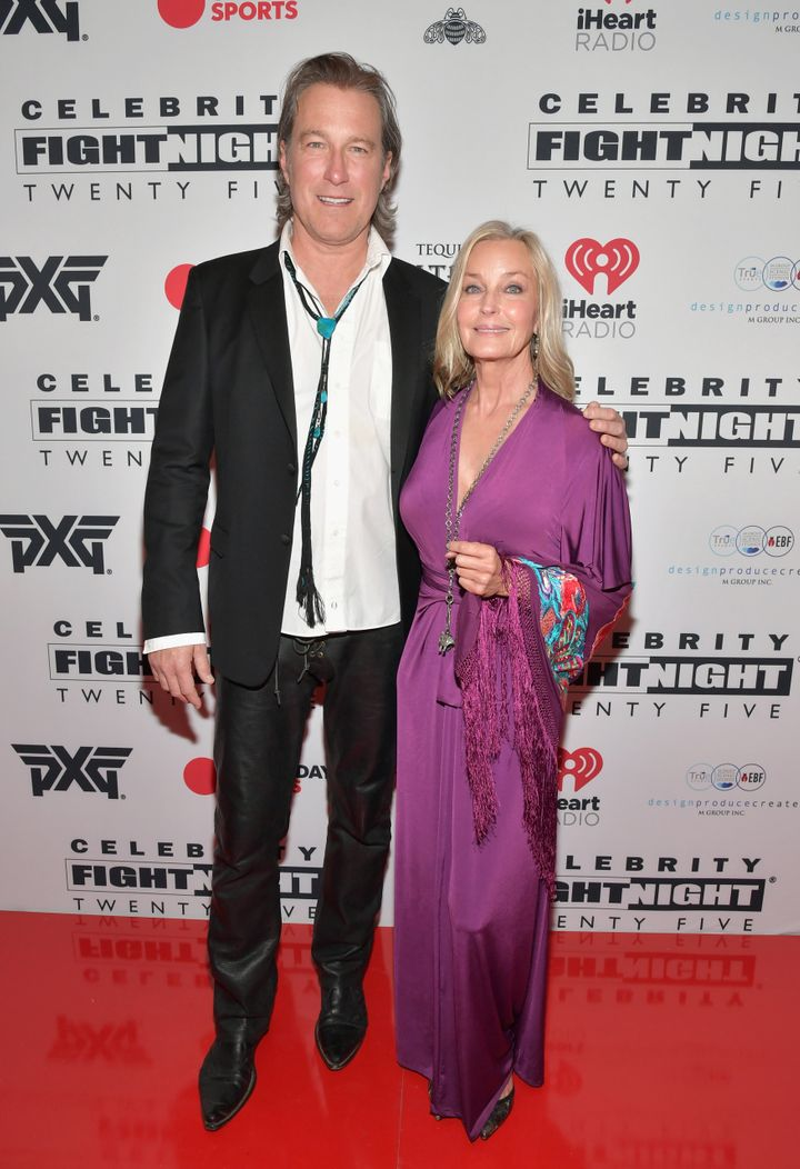 Image Credits: Getty Images / / The model and Hollywood actor Bo Derek and John Corbett are photographed by the press.