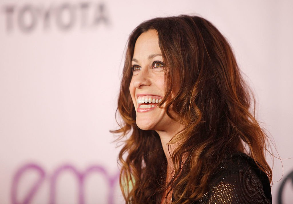 Image Credits: Getty Images / Michael Tran / FilmMagic | Alanis Morissette arrives to the 20th Anniversary - 2009 EMA Awards held on the backlot at Paramount Studios on October 25, 2009 in Los Angeles, California.