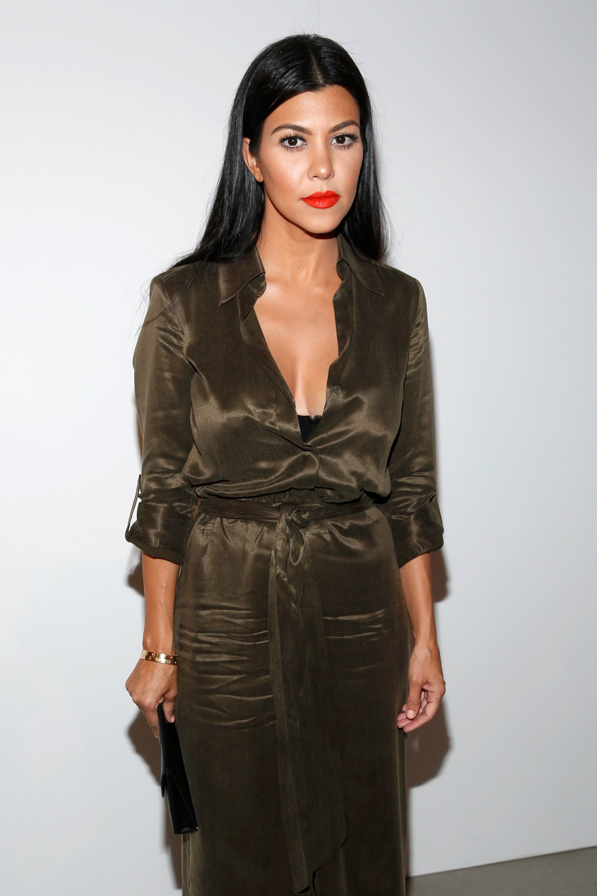 Image Credits: Getty Images |  Kourtney Kardashian posing for a photograph