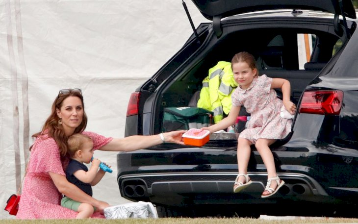 Image Credit: Getty Images / Catherine, Duchess of Cambridge, Prince Louis of Cambridge and Princess Charlotte of Cambridge at Billingbear Polo Club on July 10, 2019.