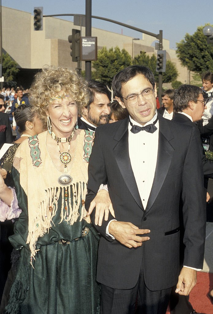 Image Credits: Getty Images / Ron Galella / Ron Galella Collection | Betty Thomas and actor Reni Santoni attending 38th Annual Primetime Emmy Awards on September 21, 1986 at the Pasadena Civic Auditorium in Pasadena, California.
