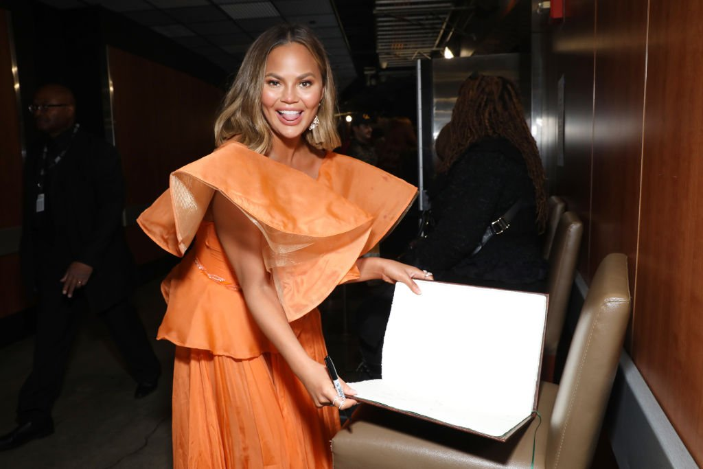 Image Credit: Getty Images / Chrissy Teigen is seen at the GRAMMY Charities Signings during the 62nd Annual GRAMMY Awards at STAPLES Center on January 26, 2020 in Los Angeles.
