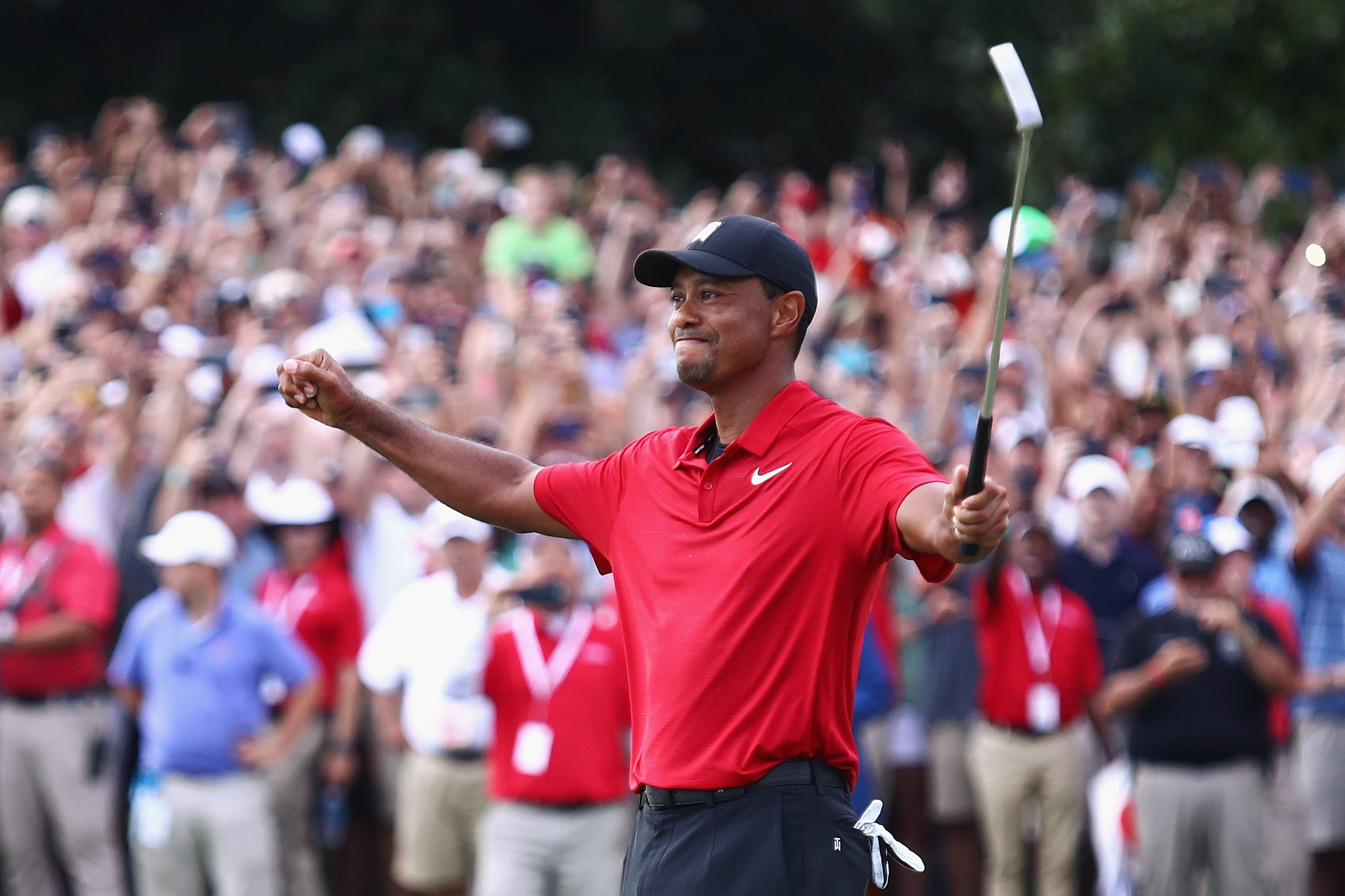 Image Credits: Getty Images / Tim Bradbury | Tiger Woods of the United States celebrates making a par on the 18th green to win the TOUR Championship at East Lake Golf Club on September 23, 2018 in Atlanta, Georgia.