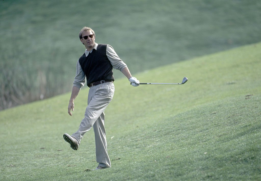 Image Credit: Getty Images / Actor Kevin Costner in action during the AT&T Pebble Beach National Pro-Am Golf Tournament held at the Pebble Beach Golf Links, California, circa February 1996.