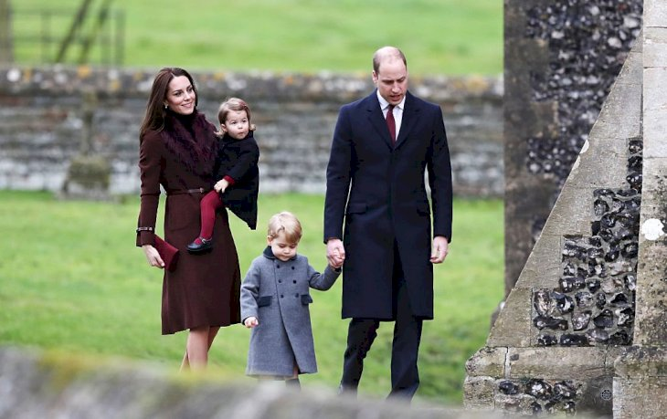 Image Credit: Getty Images / Catherine, Duchess of Cambridge and Prince William, Duke of Cambridge, Prince George of Cambridge and Princess Charlotte of Cambridge arrive to attend the service at St Mark's Church on Christmas Day.