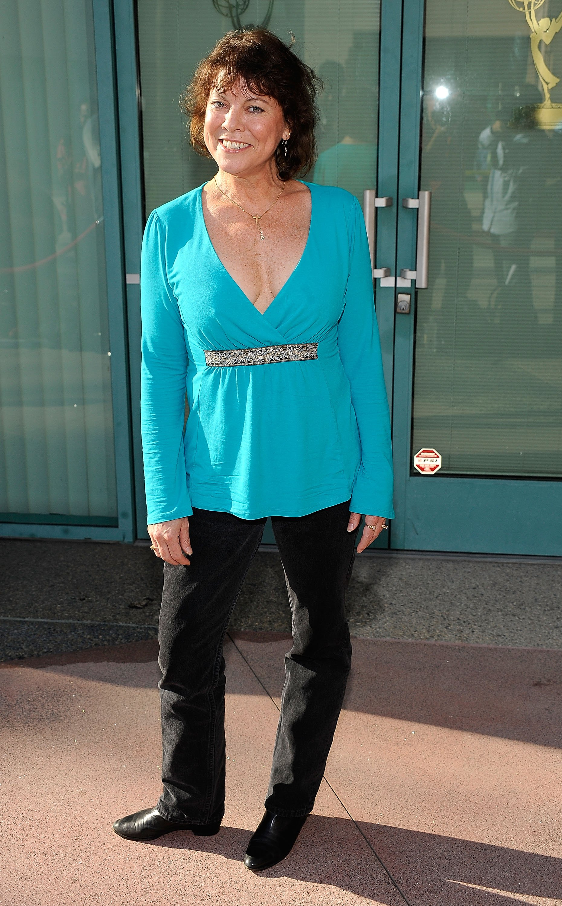 Image Source: Getty Images | Erin Moran posing for the camera