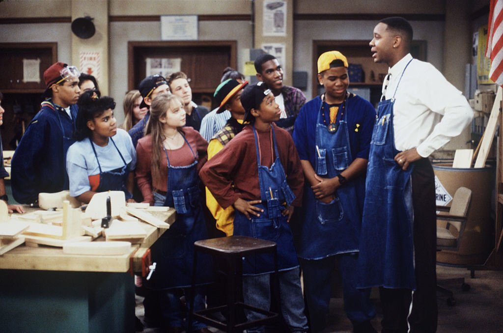 "Image Credits: Getty Images / Walt Disney Television | Mark Curry (as Mr. Cooper) stars in the T.V series ""Hanging with Mr. Cooper."" A single high school teacher and basketball coach living in Oakland, California. Omar Gooding (second from right) co-stars as Earvin Rodman."