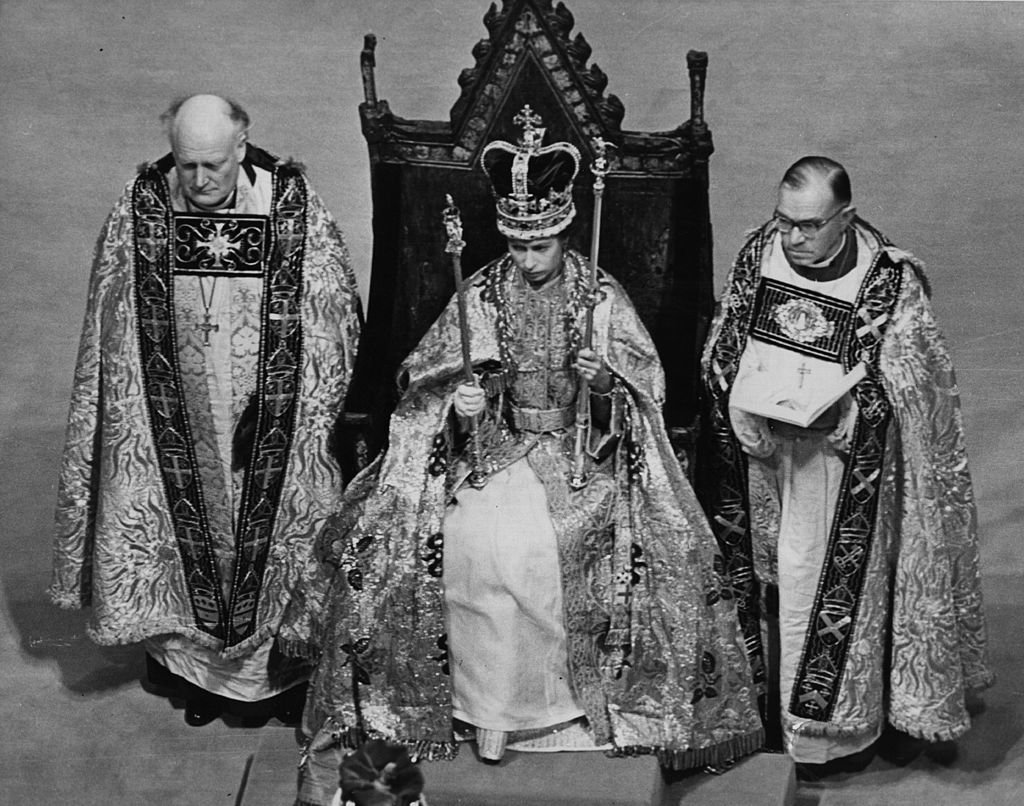Image Credit: Getty Images / The Queen holding her symbols of office after the crowning ceremony on 2nd June 1953.