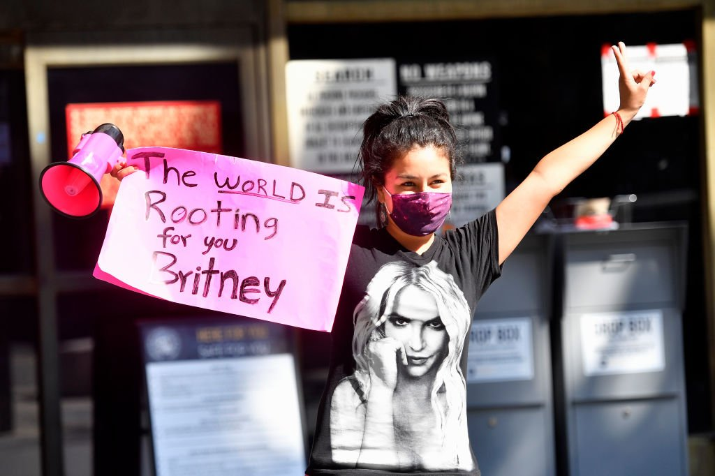Image Credit: Getty Images / A supporter of Britney Spears gathers with others outside a courthouse in downtown for a #FreeBritney protest as a hearing regarding Spears' conservatorship is in session on July 22, 2020.