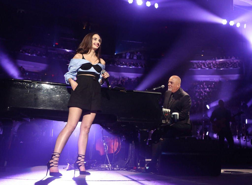 Image Credits: Getty Images / Myrna M. Suarez | Alexa Ray Joel joins her father Billy Joel for the first time ever singing Baby Grand at Billy Joel's 53rd consecutive sold out show at Madison Square Garden on June 2, 2018 in New York City.