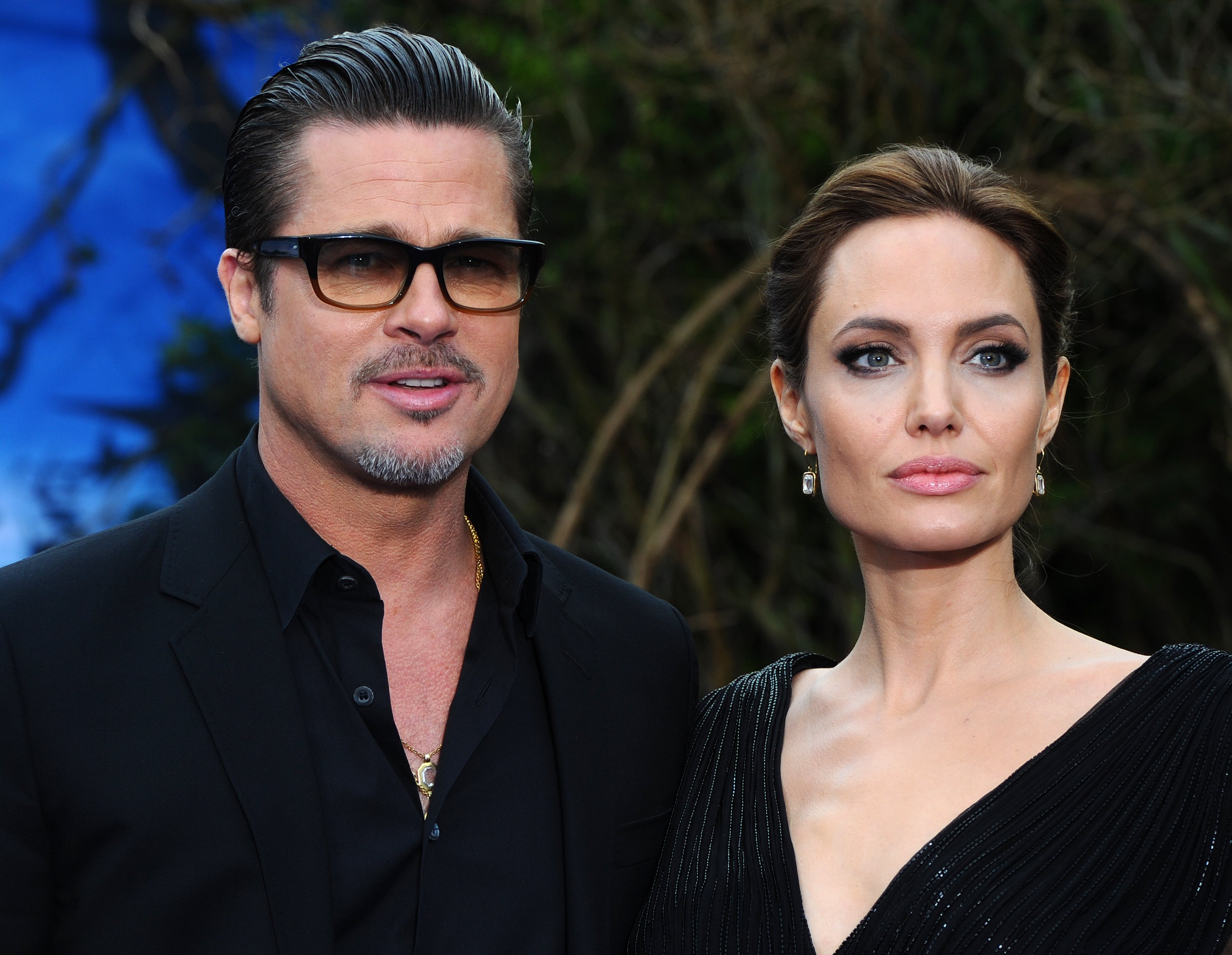 "Image Credit: Getty Images/Anthony Harvey | Brad Pitt and Angelina Jolie at a  Disney's ""Maleficent"" event"