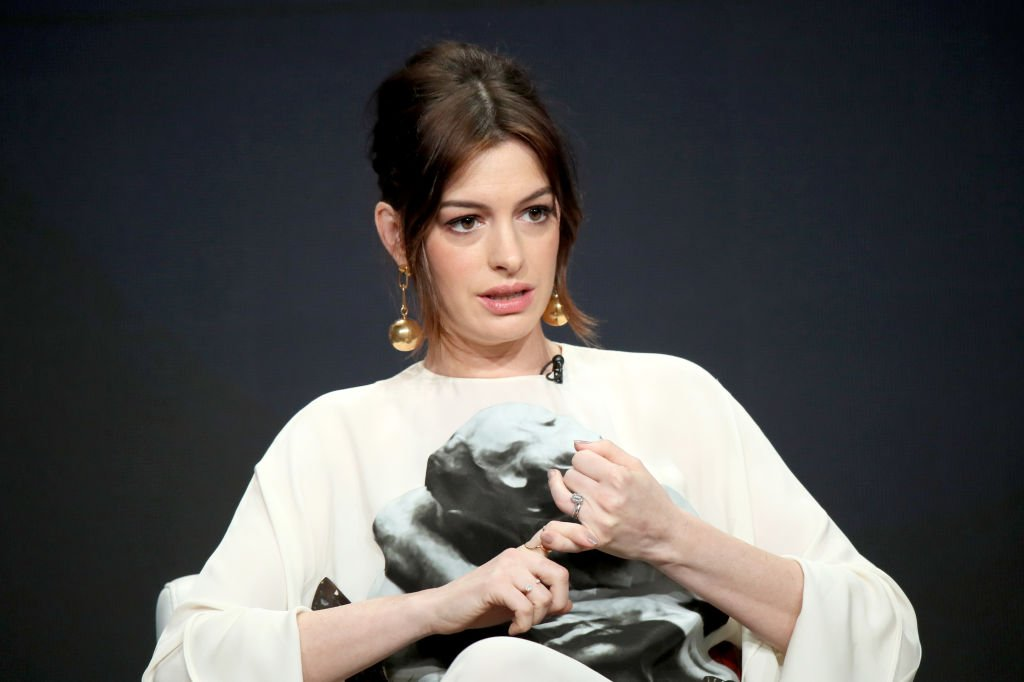 Image Credit: Getty Images / Anne Hathaway of 'Modern Love' speaks at Television Critics Association Press Tour on July 27, 2019 in Beverly Hills, California.