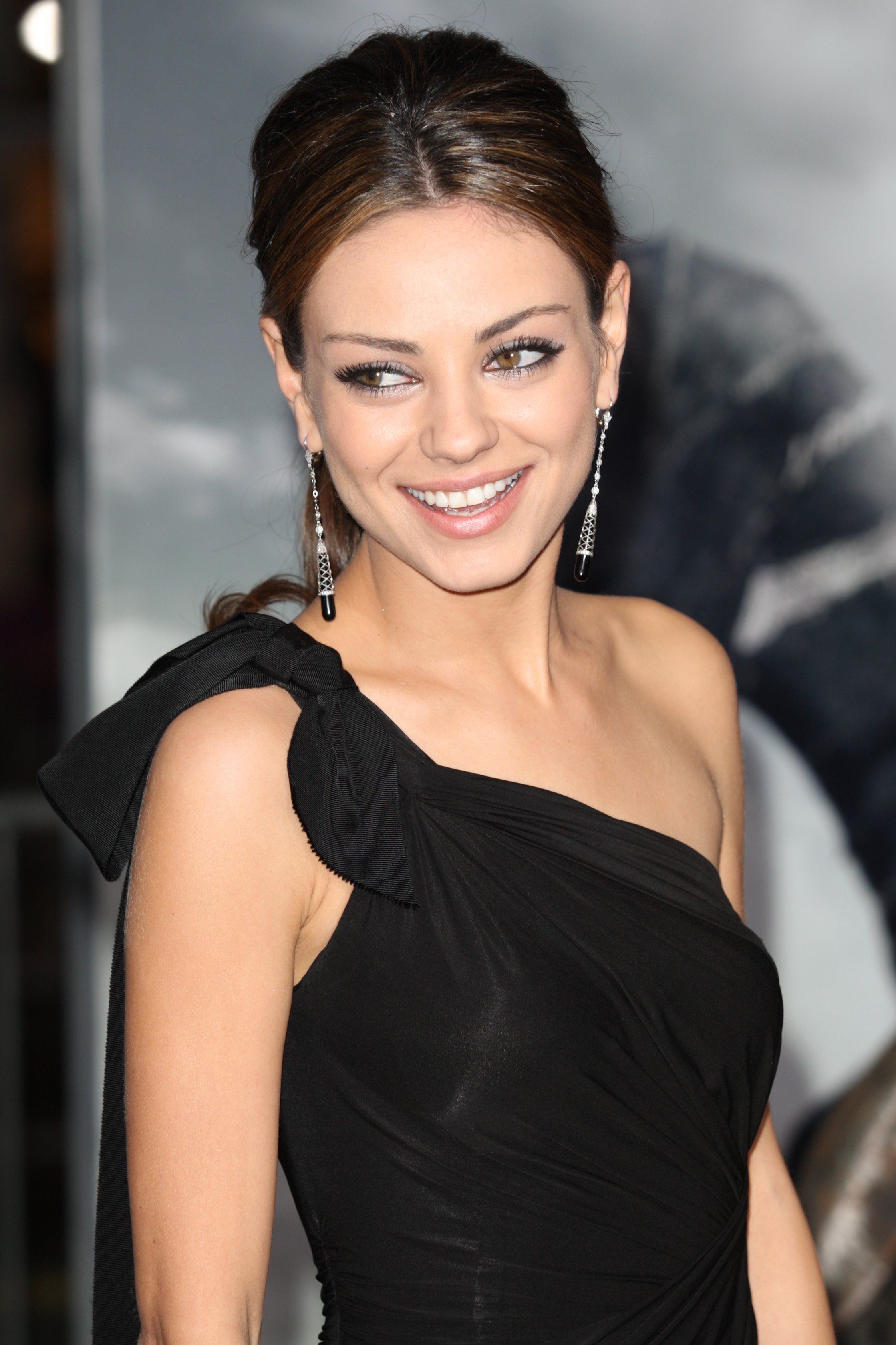 Image Credits: Shutterstock / Photo Works | Mila Kunis attends The Book of Eli premiere on January 11 2010 at Grauman's Chinese Theater in Hollywood, California.