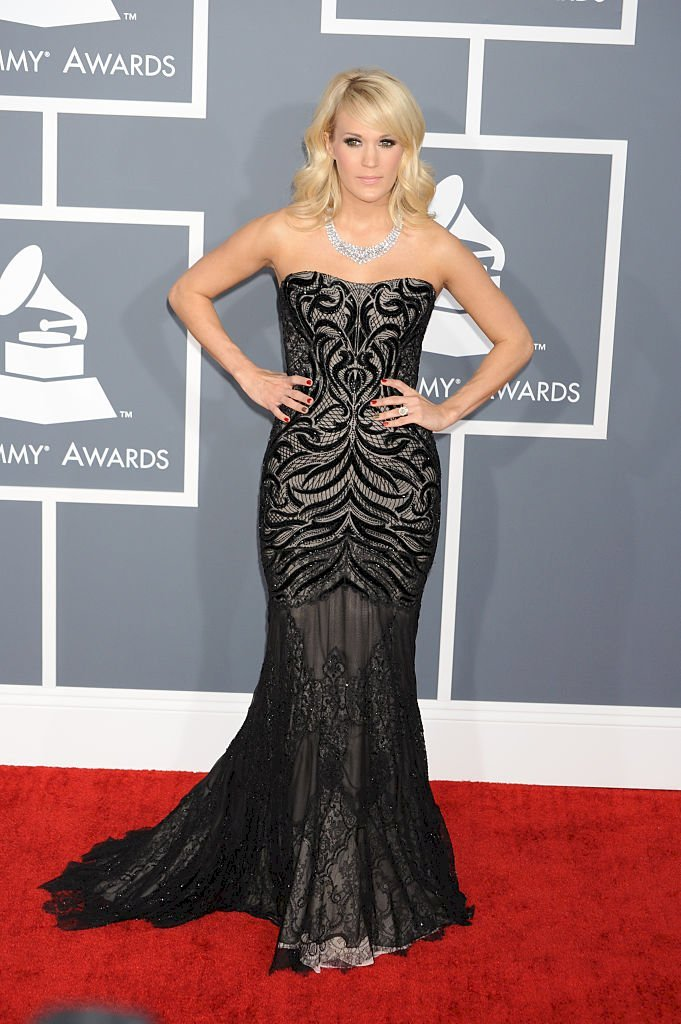 Image Credit: Getty Images/Corbis via Getty Images/Frank Trapper | Carrie Underwood at the 55th Annual Grammy Awards.