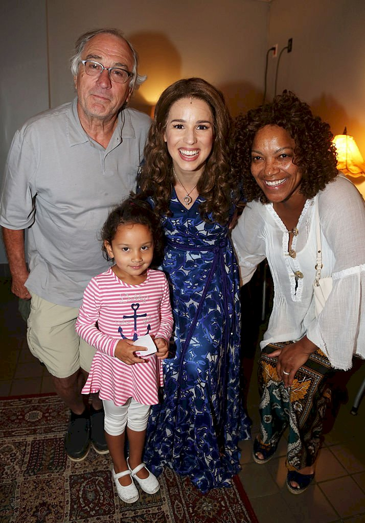 "Image Credits: Getty Images / Bruce Glikas / FilmMagic | Robert De Niro, daughter Helen Grace, Chilina Kennedy as ""Carole King"" and Grace Hightower De Niro pose backstage at the hit Carole King musical ""Beautiful"" on Broadway at The Stephen Sondheim Theater on September 2, 2015 in New York City."