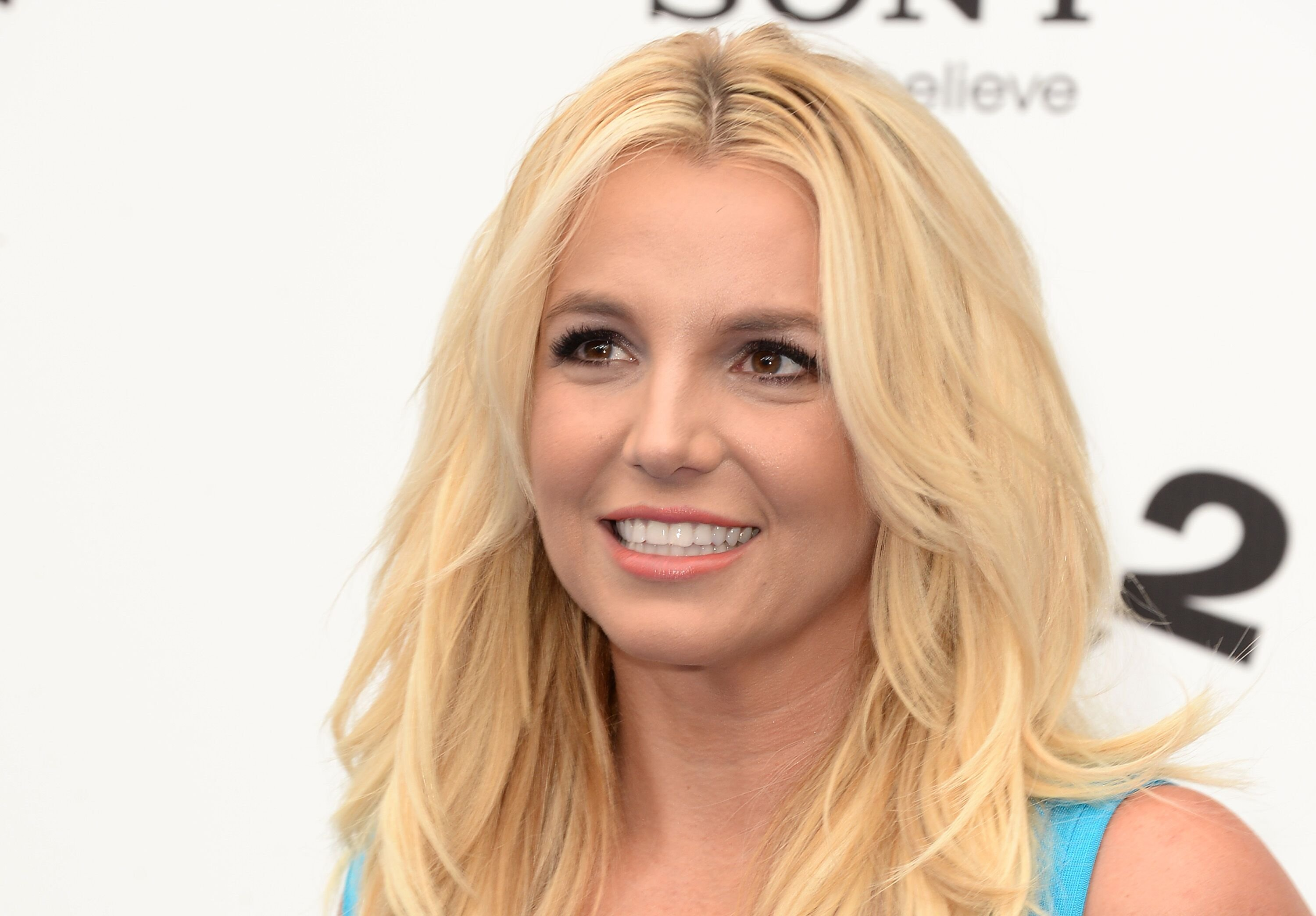 Image Credit: Getty Images / Singer Britney Spears poses for a picture.