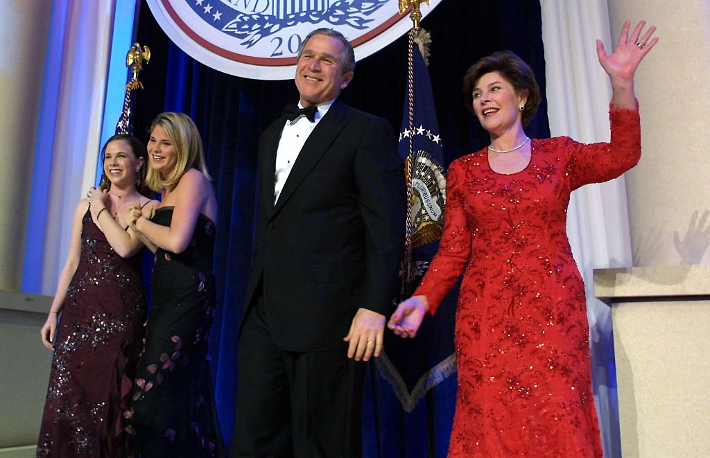Image Credits: Getty Images / Brooks Kraft LLC / Sygma | United States President George W. Bush (C), his wife Laura, and daughers Jenna and Barbara, attend the first inaugural ball in Washington, DC. The Bushes were scheduled to attend eight presidential inaugural balls.