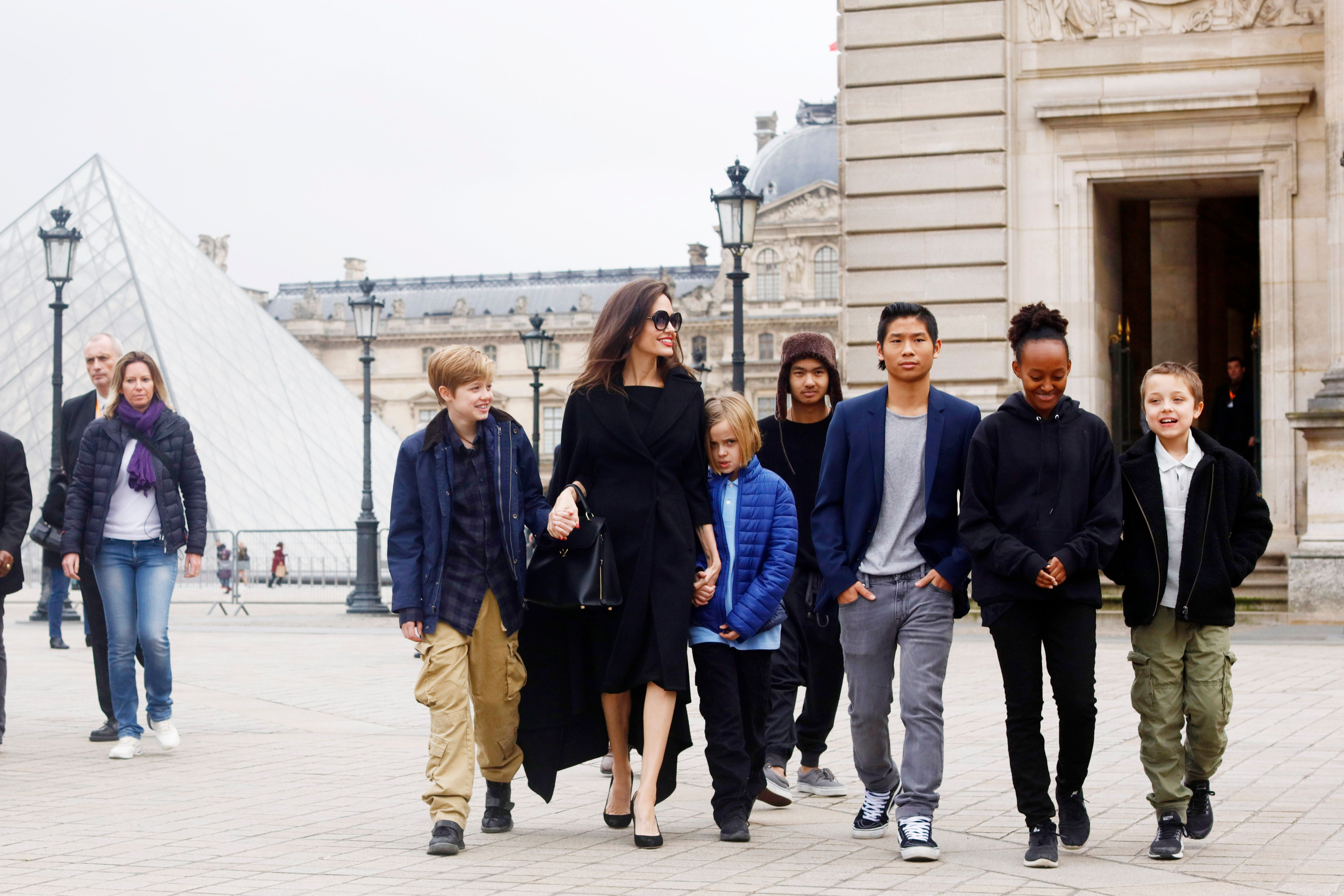 Angelina Jolie with her children Shiloh Pitt Jolie, Maddox Pitt Jolie, Vivienne Marcheline Pitt Jolie, Pax Thien Pitt Jolie, Zahara Marley Pitt Jolie, Knox Leon Pitt Jolie, visit the Louvre in Paris, France (Photo by Mehdi Taamallah/NurPhoto via Getty Images)