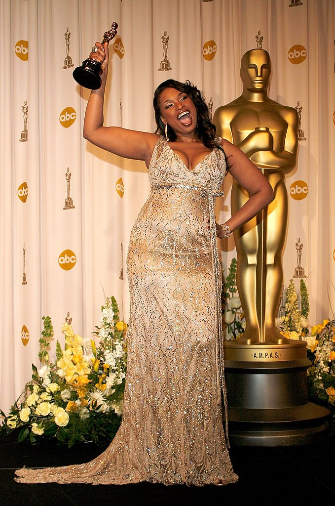 Image Credits: Getty Images / Vince Bucci | Jennifer Hudson poses in the press room with her Oscar