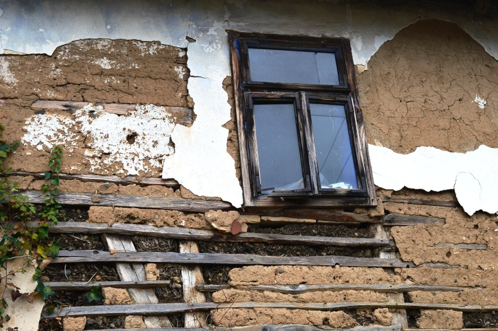 Window on old abandoned house  | Shutterstock