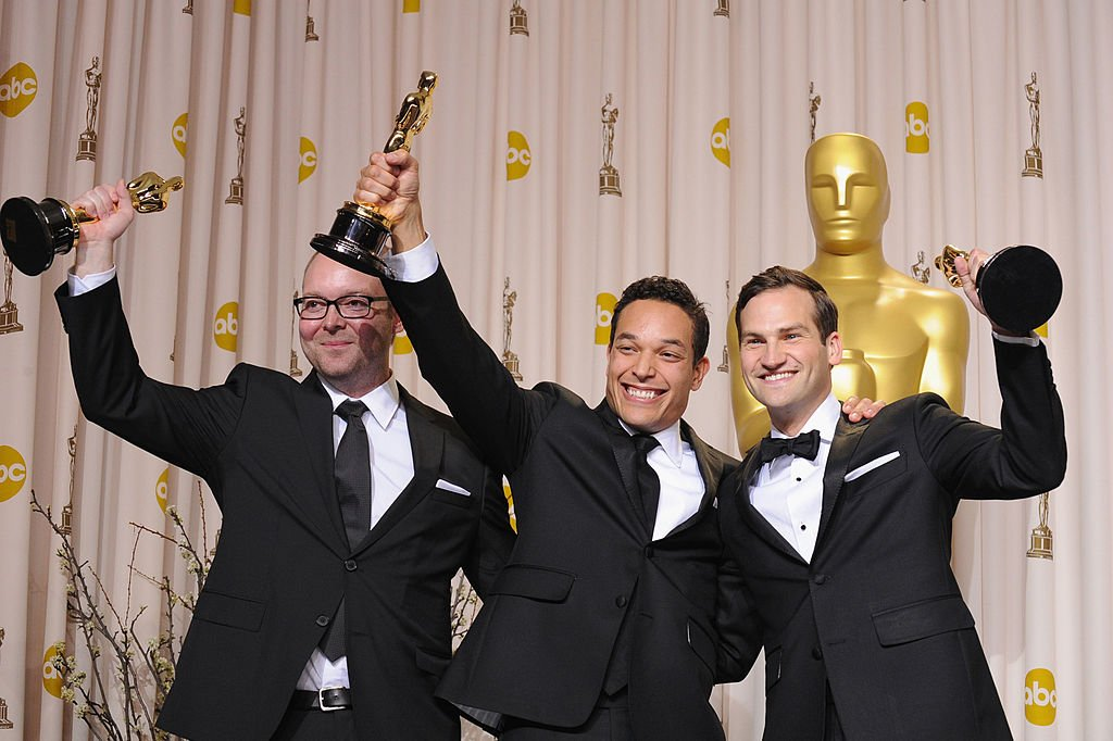 Image Credits: Getty Images / Steve Granitz/WireImage | Producer Rich Middlemas, directors T.J. Martin and Dan Lindsay pose in the press room