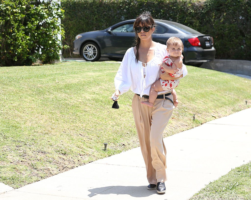 Image Credit: Getty Images / Kourtney Kardashian and Penelope Disick are seen on June 08, 2013 in Los Angeles, California.