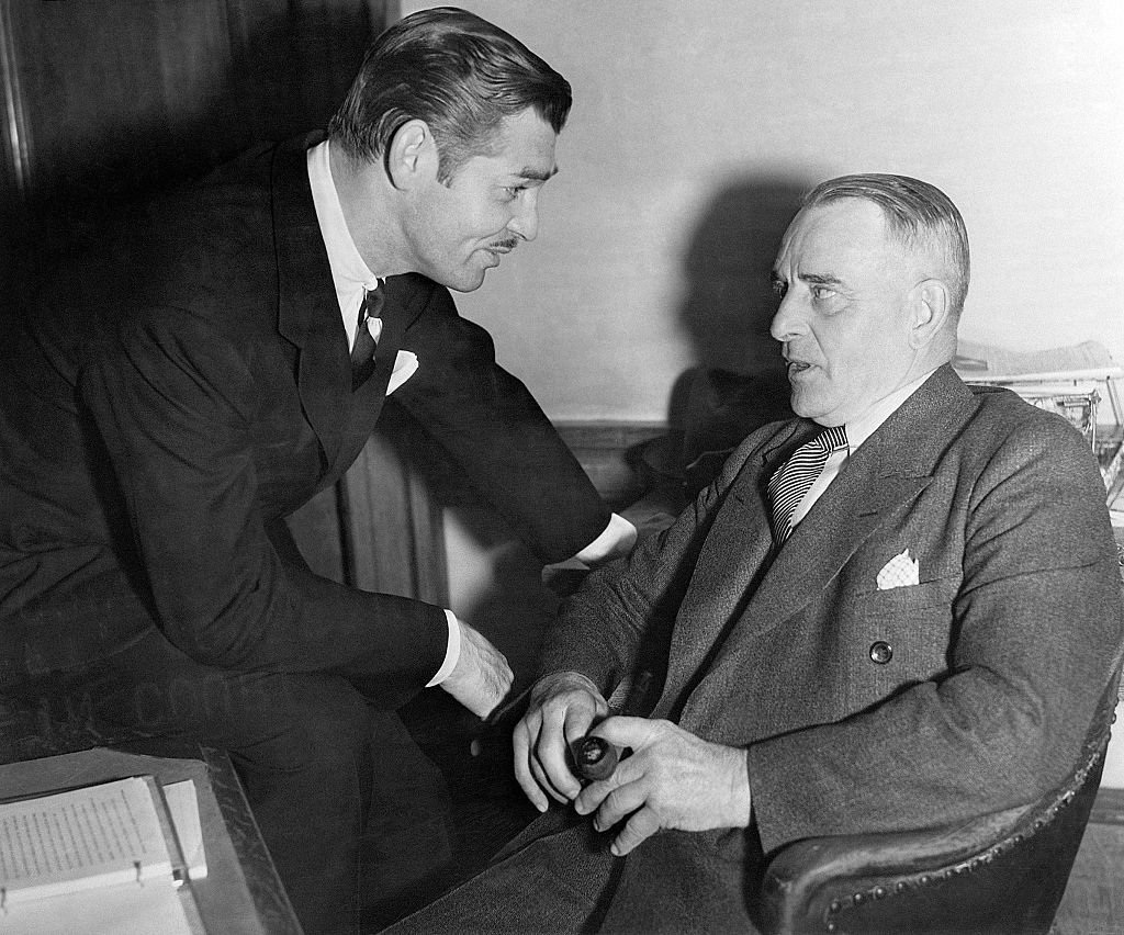Image Credit: Getty Images / Actor Clark Gable also called The King of Hollywood poses for a picture with his father.