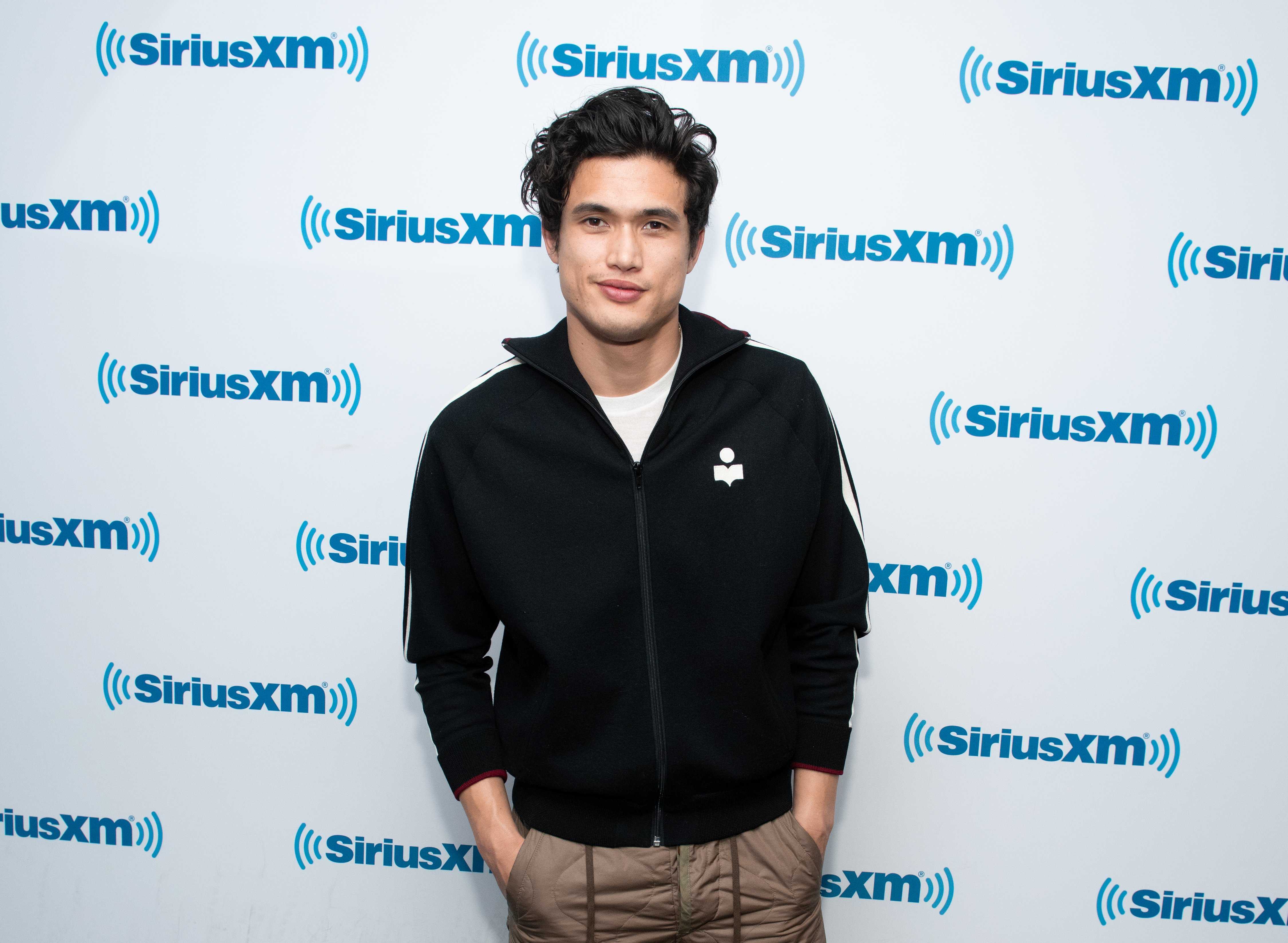 Image Source: Getty Images| Charles posing at the even of Sirius XM