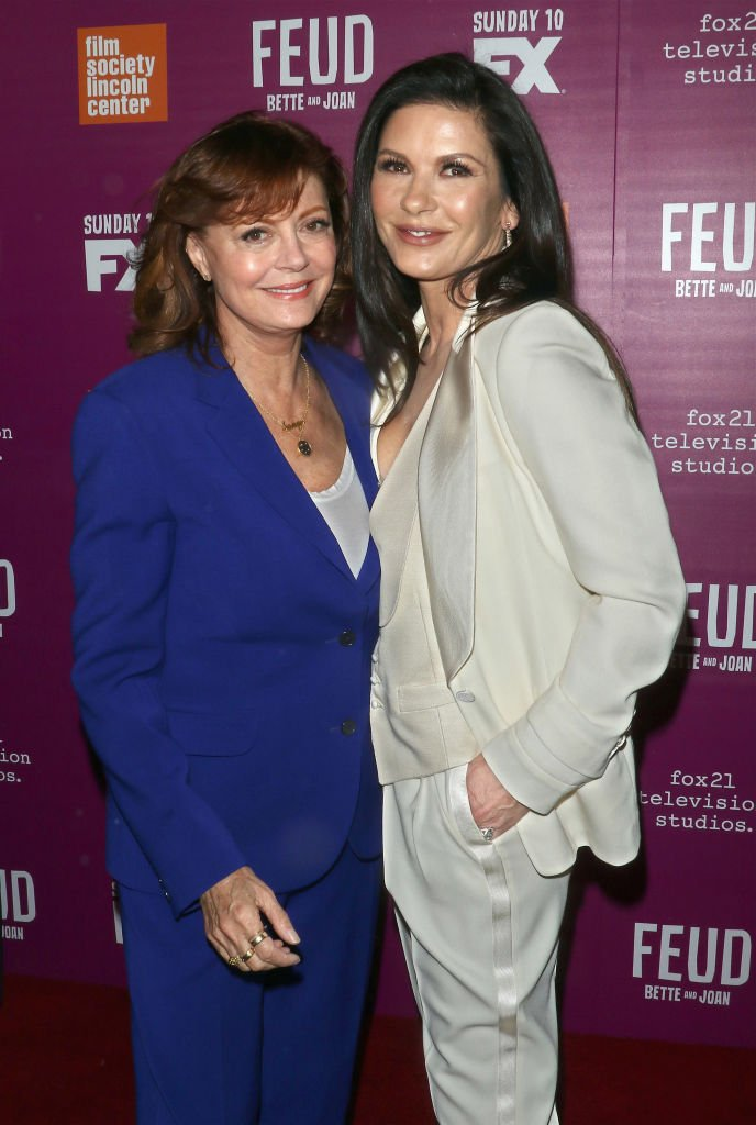 "Image Credits: Getty Images / Jim Spellman/WireImage | Actresses Susan Sarandon (L) and Catherine Zeta-Jones attend the ""Feud: Bette and Joan"" NYC event at Alice Tully Hall at Lincoln Center"