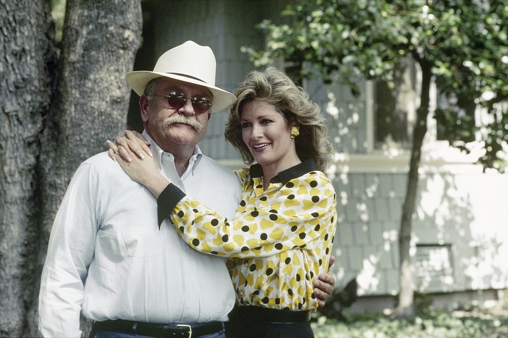 Image Credit: Getty Images / Wilford Brimley as Gus Witherspoon and Deidre Hall as Jessica 'Jessie' Witherspoon on set for season 1 of Our House.